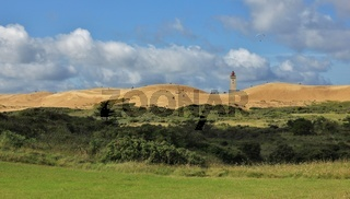 View of the Rubjerg Knude. High sand dune at the west coast of Denmark. Old lighthouse partly covered by sand.
