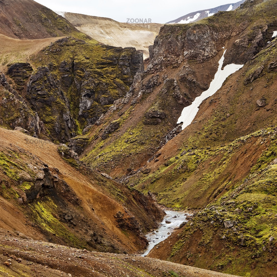 canyon, river and snow fields in mountainous landscape, Kerlingarfjoell, Iceland, Europe