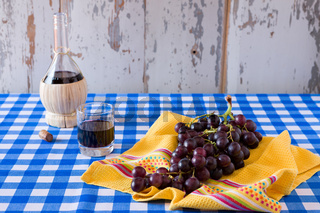 Bunch of red grapes and a glass of red wine