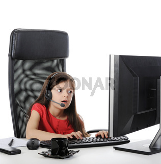 girl with astonishment looks in the computer