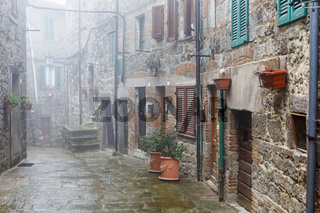 Misty alley in an Italian village