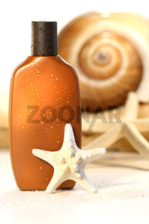 Suntan lotion with seashells