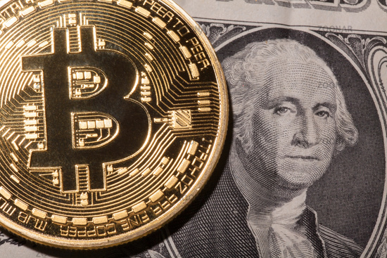 One Bitcoin on dollar banknote.