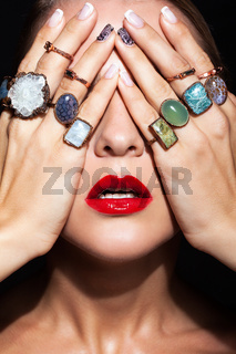 Young woman  with  with many bijouterie rings with stones on fingers