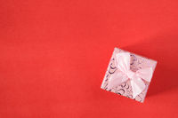 Small gift on red background