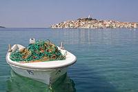 Fishing boat with Primosten in Dalmatia