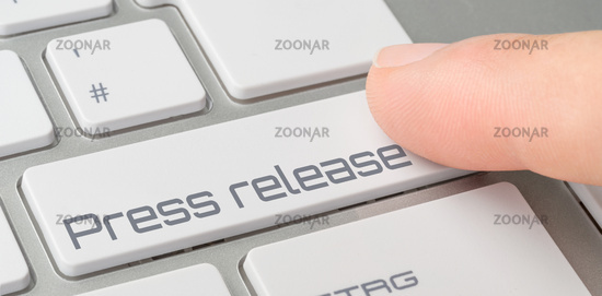 A keyboard with a labeled button - Press release