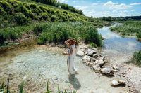 Woman on water in white dress