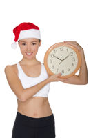 happy asian women in a Santa's hat with a clock