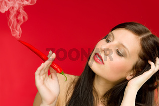Chili pepper portrait young woman smoke red hot