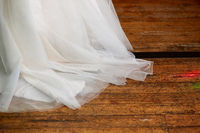 Wedding dress on floorboard