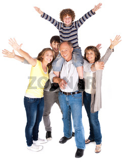 Happy family of five with young kid