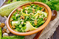 Salad with squash and sorrel on board