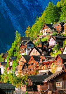 Traditional wooden houses on the mountain slope in Hallstatt, Austria