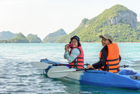 Mother and daughter take pictures on kayak