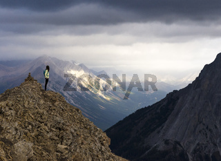 Female hiker looking at out from mountain peak