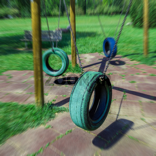 Tire swings hanging in park
