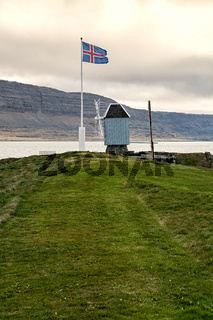 Windmill and Icelandic flag in Vigur island, Iceland