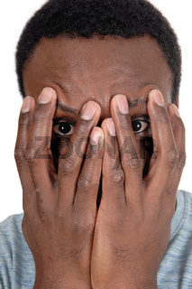African man holding his hands over face