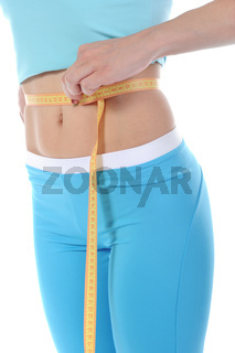 Young sports girl measuring waist.
