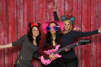party with fotobox - girl posing with guitar in front photo booth