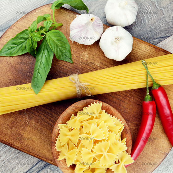 Raw spagetti and farfalle pasta on the table