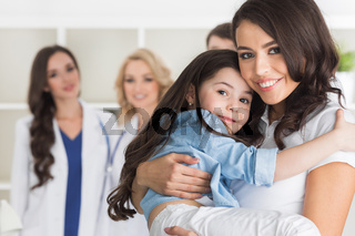 Mother and daughter in clinic