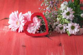 Decorative heart on pink flowers