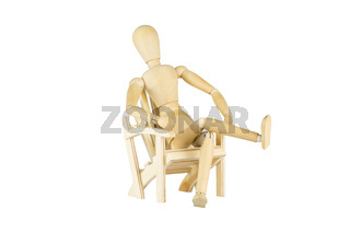 Wooden mannequin on a wooden chair