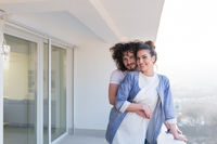 Couple hugging on the balcony