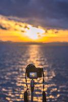 Camera on a tripod capturing the sunset