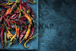 Dried hot peppers, food background
