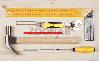 Set of working tools for carpentry works on the wooden table
