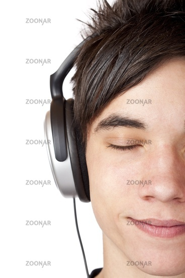 Close-up macro of a male teenager listening to mus