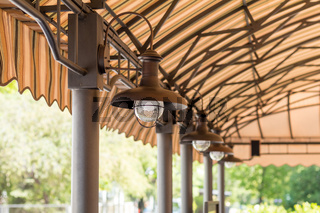 Streetlights under the summer cafeteria canopy. Architectural composition