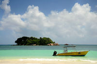 Seychelles smal island in front of Praslin with boat