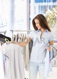 Pretty woman purchasing clothes