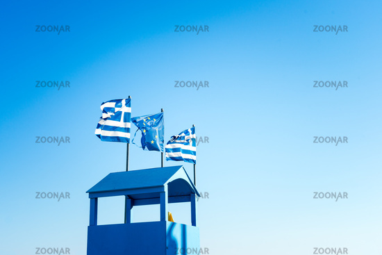 Greek Flag And EU Flag, Blue Sky And Viewpoint Hut In Blue Color In Palaria Katerini, Greece