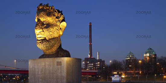 illuminated sculpture Echo des Poseidon in the twilight in port of Duisburg, Ruhr Area, Germany
