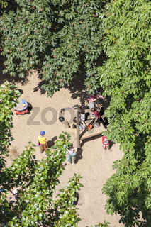 Aerial view of a playground with some playing children