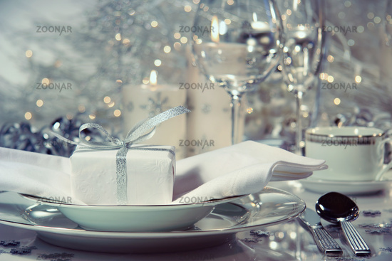 Closeup of dinner setting with gift for the holidays