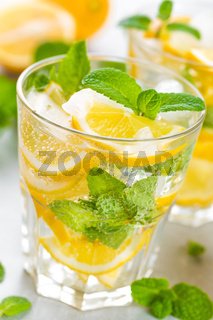 Lemon mojito cocktail with fresh mint, cold refreshing summer drink or beverage with ice