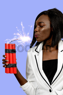 Young woman holding dynamite