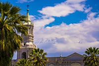 Cathedral of Arequipa at plaza de Armas with Palm trees, Peru with mountains