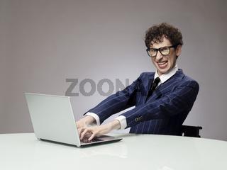 Funny man using laptop