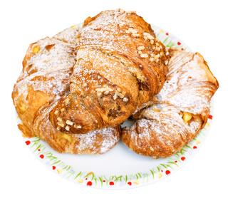 three fresh croissants on plate
