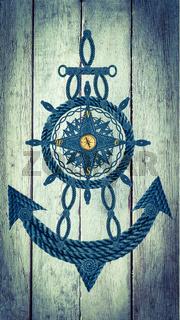 Kompass Anker Steuerrad auf Holz