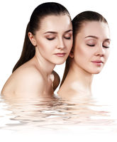 Two sensual women in water.