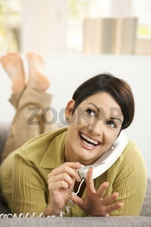 Woman filing nails while chatting