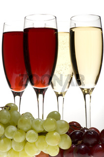 champagne glasses with grapes on grey closeup